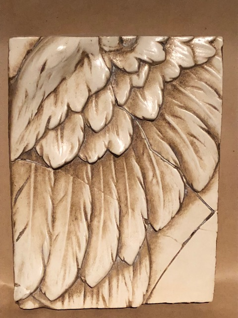 Wing plaque
